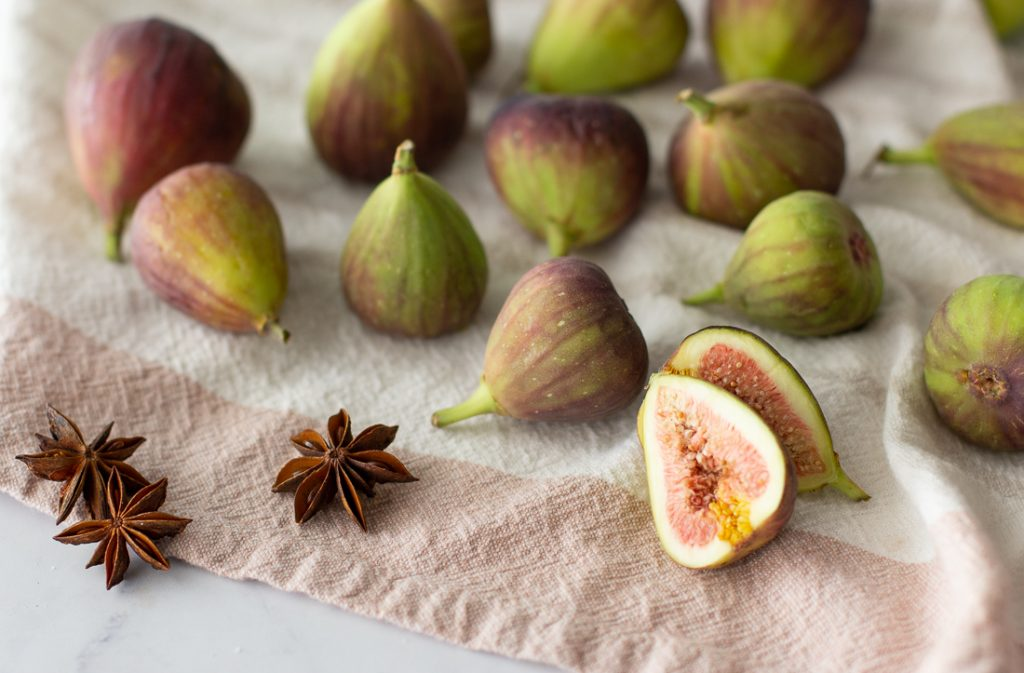 fresh figs and star anise on linen towel