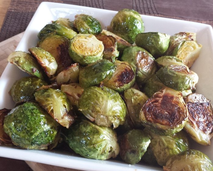 brussels sprouts with vanilla garlic butter in square white bowl on brown cloth background