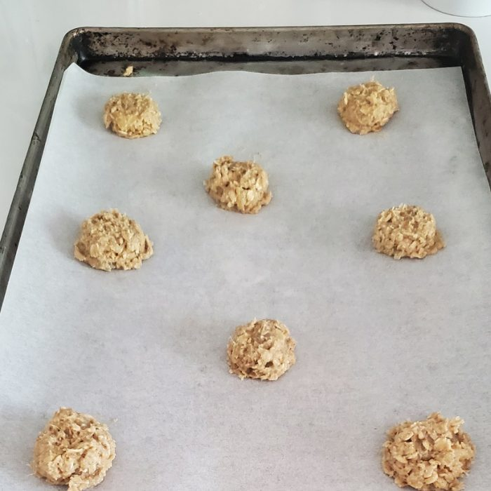 ginger lace cookie dough portioned on parchment lined pan