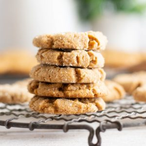 close up of stack of gluten free peanut butter cookies on round wire rack