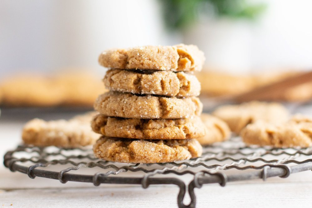 close up of stack of flourless peanut butter cookies on round wire rack