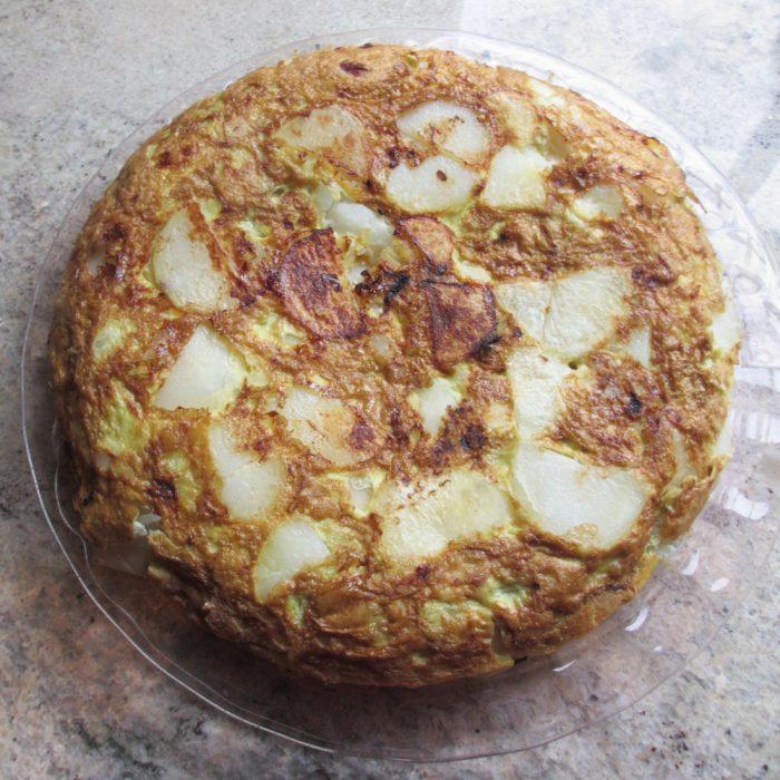 overhead shot of whole egg and potato fritatta on countertop