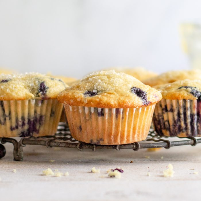 close up of blueberry muffins on round wire rack
