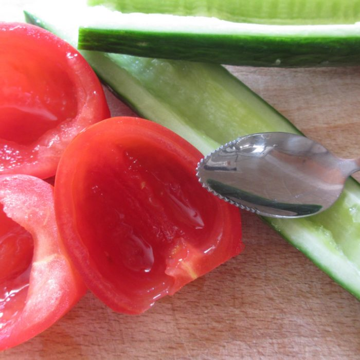 cucumber halves and cherry tomato halves with seeds removed