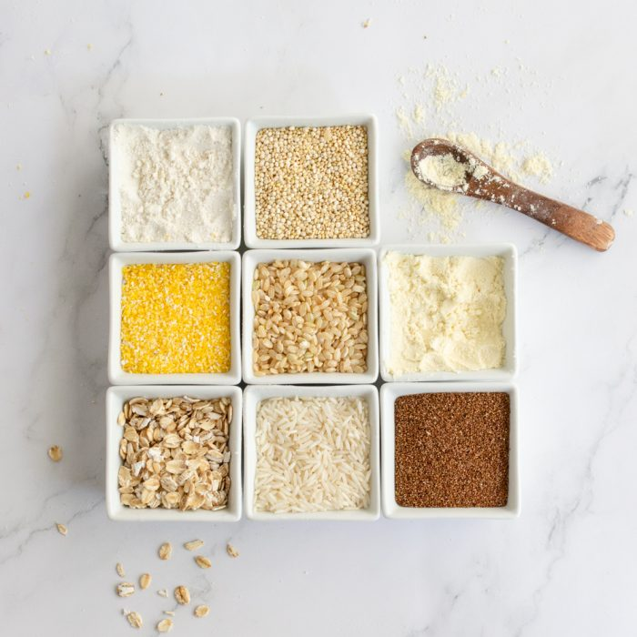 overhead view of gluten-free grains in square white bowls
