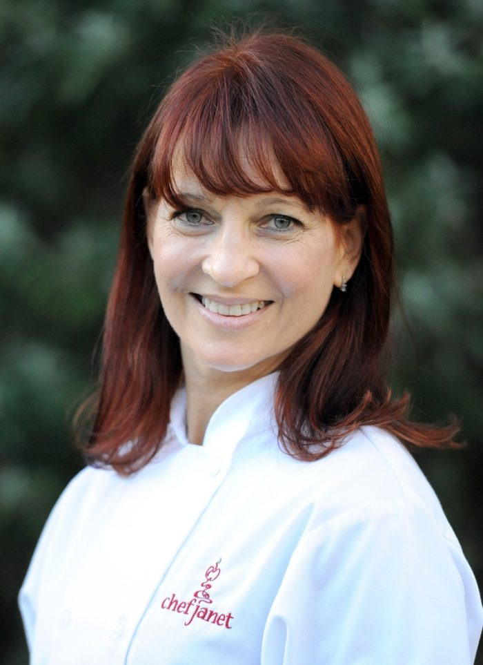headshot of chef janet in white chef coat