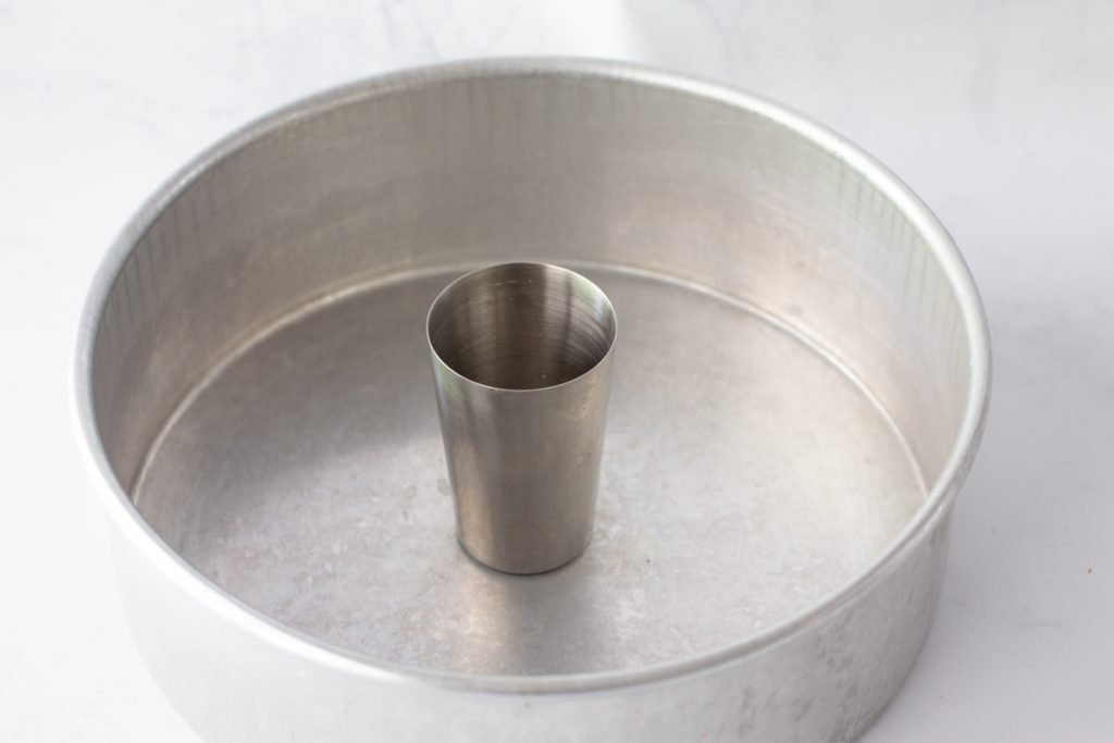 "9"" cake pan with metal cup in center"