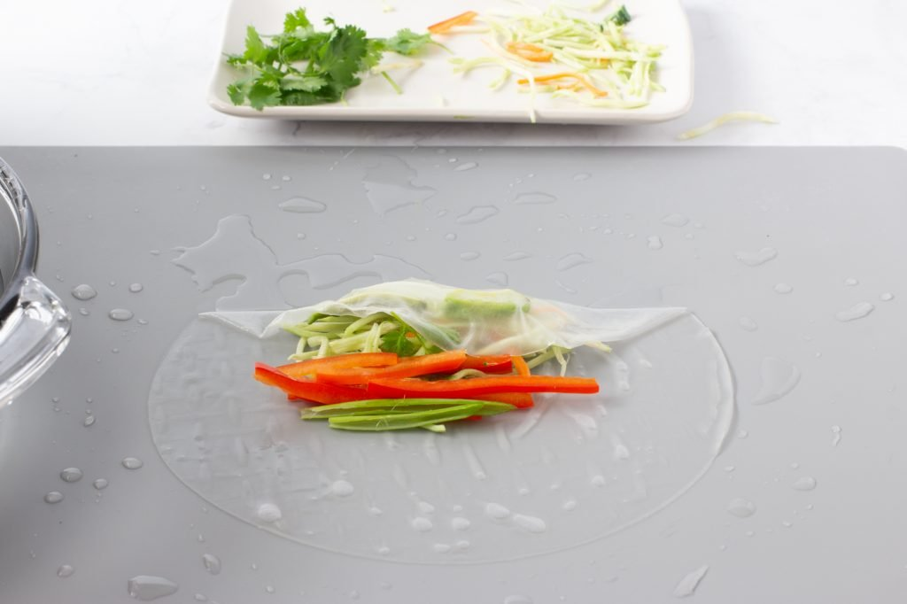 rice paper wrap with veggies. top of wrapper folded down