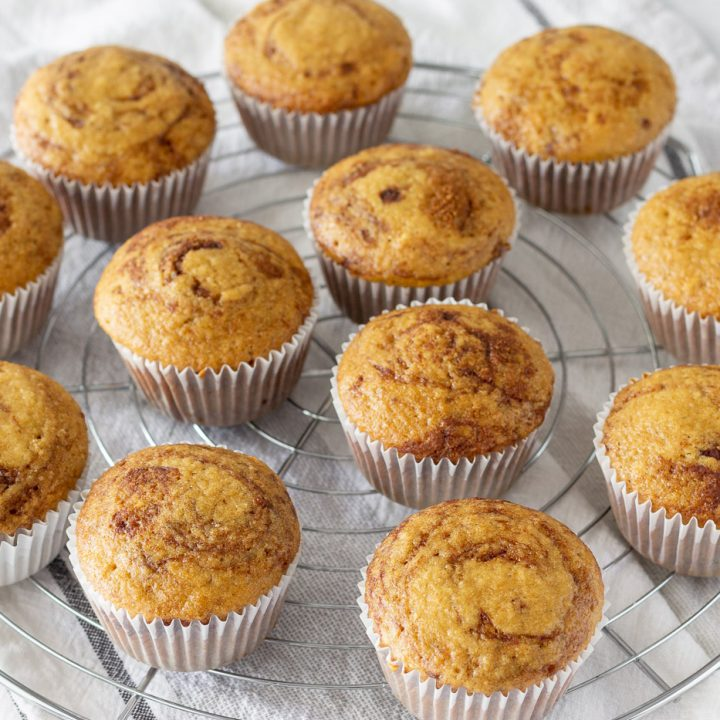 gluten free dairy free muffins with cinnamon and apple on round wire rack