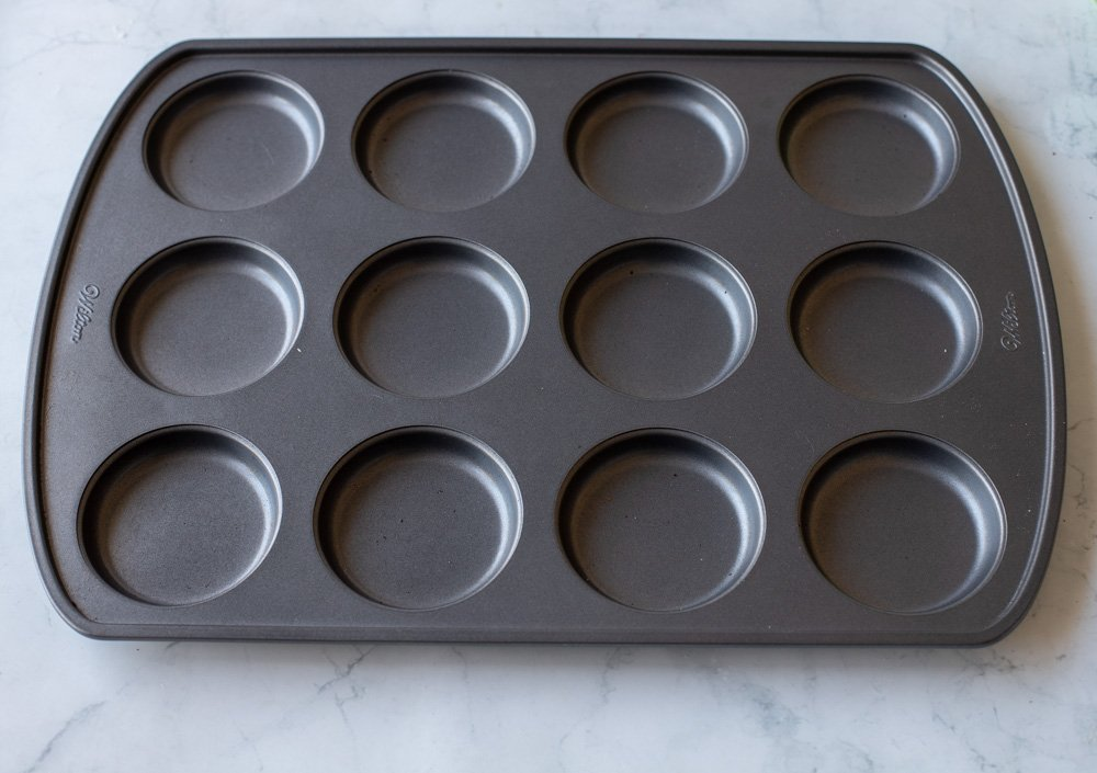 wilton 12 well whoopie pie pan on white marble surface.